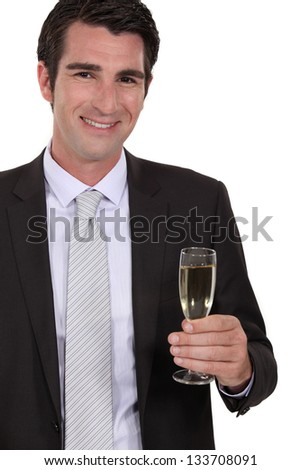 Confident businessman holdingvchampagne - stock photo