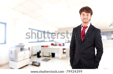 Confident businessman in his office - stock photo