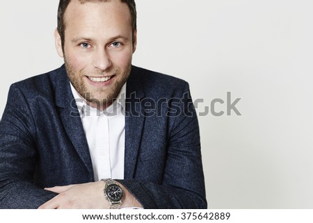 Confident businessman in suit jacket, portrait - stock photo