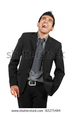 Confident businessman laughing out loud. isolated on white - stock photo