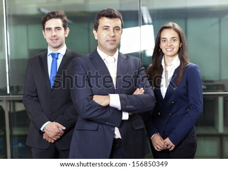 Confident businessman leader on the foreground of his team
