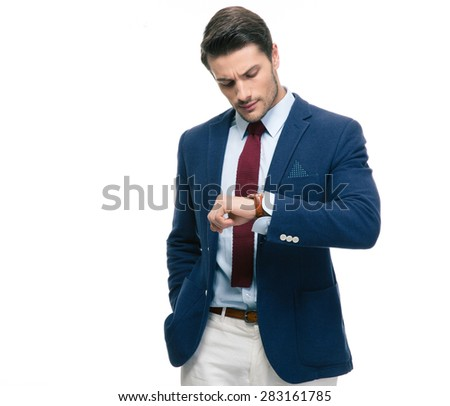 Confident businessman looking on his wrist watch isolated on a white background - stock photo