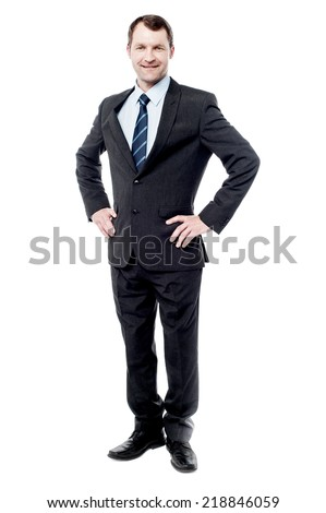 Confident businessman posing with hands on his waist - stock photo