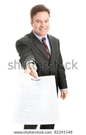 Confident businessman presenting his resume. Resume is entirely fictional with no trademarked or copyrighted information. - stock photo