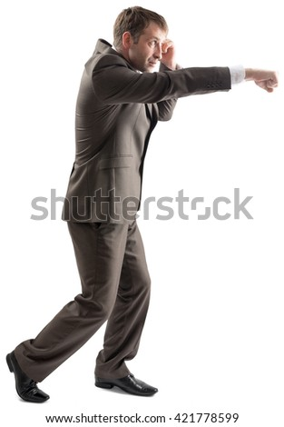 Confident businessman ready for fight isolated on white background