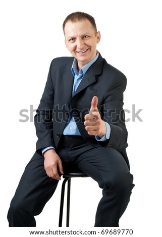 Confident businessman showing thumbs up sign and smiling, isolated on white - stock photo