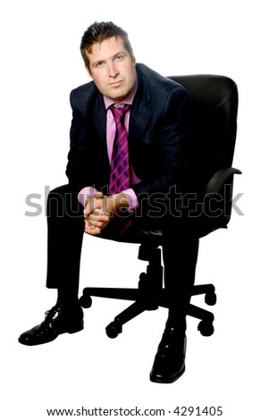 Confident businessman sitting on black corporate leather chair, isolated. - stock photo