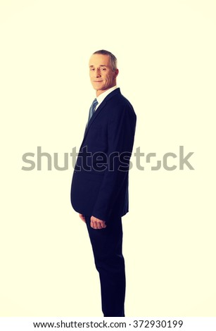 Confident businessman standing - stock photo