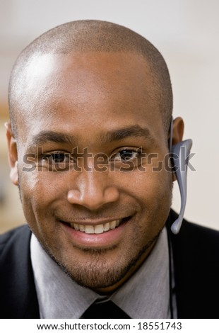 Confident businessman wearing wireless headset