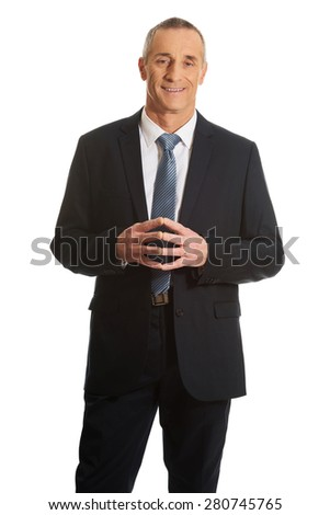 Confident businessman with clenched hands. - stock photo