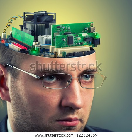 Confident businessman with computer in head - stock photo