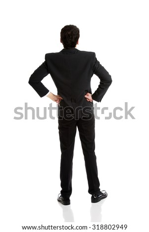 Confident businessman with hands on hips. - stock photo