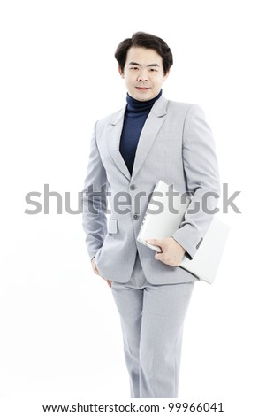 Confident businessman working on his computer - stock photo