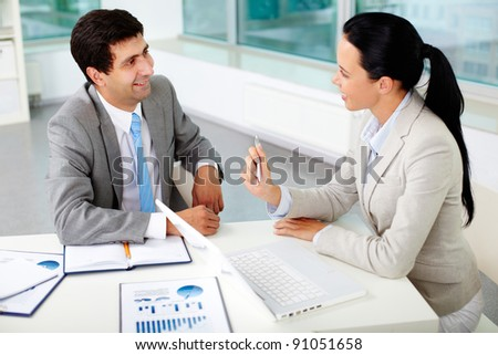 Confident businesswoman explaining her ideas to employer at meeting - stock photo