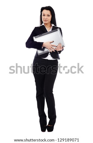 Confident businesswoman holding a laptop in her hands in full length pose isolated on white background. Business concept - stock photo