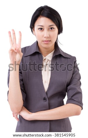 confident businesswoman pointing up 3 fingers gesture - stock photo