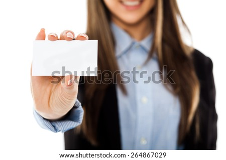 Confident businesswoman showing a blank business card, isolated on white - stock photo