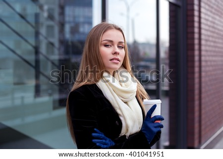 Confident businesswoman standing outdoors in autumn - stock photo