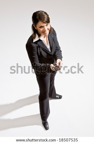 Confident businesswoman text messaging on cell phone - stock photo
