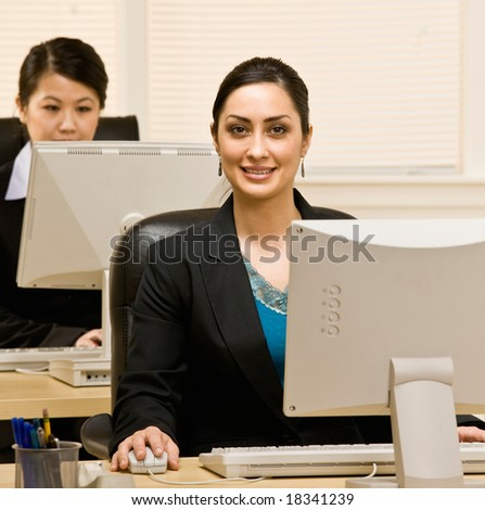 Confident businesswoman working on computer at her desk