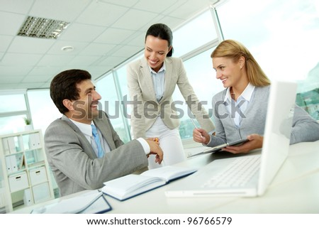 Confident businesswomen explaining their ideas to employer at meeting - stock photo