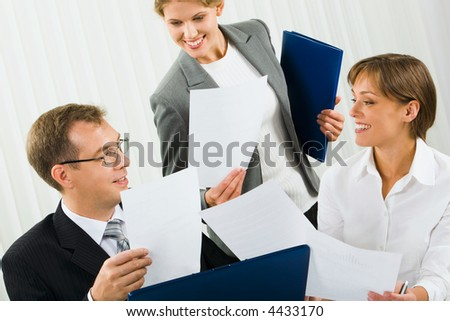Confident businesswomen is showing research results to her boss in the office