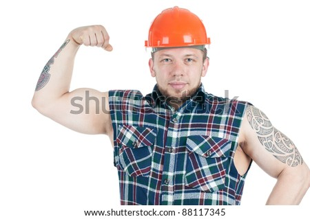 Confident caucasian manual worker in work shirt and hardhat demonstrating his biceps, isolated over white - stock photo
