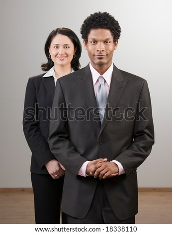 Confident co-workers in suits posing