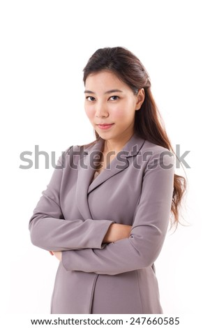 confident, cool, beautiful business woman looking at you, crossing arms - stock photo