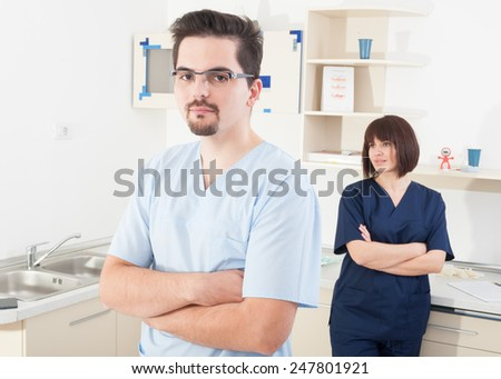 Confident dentist people in dental office - stock photo