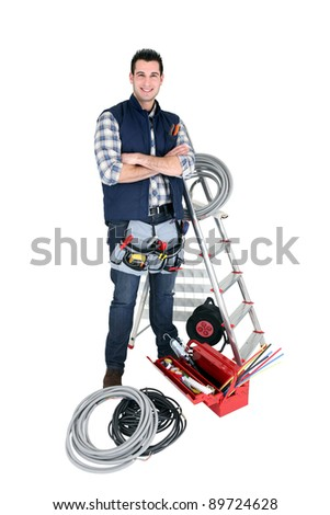 Confident electrician standing on white background - stock photo