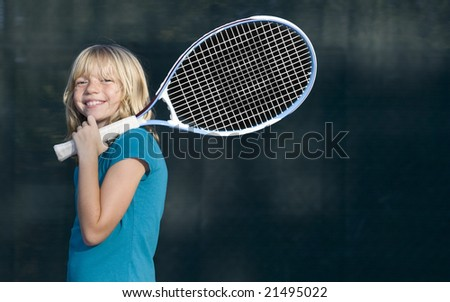 Confident Elementary Age Girl on the Tennis Court - stock photo