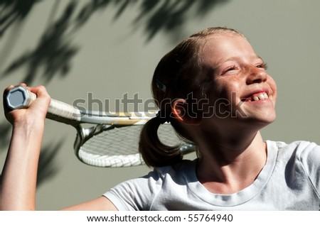 Confident Elementary Age Girl on the Tennis Court. - stock photo