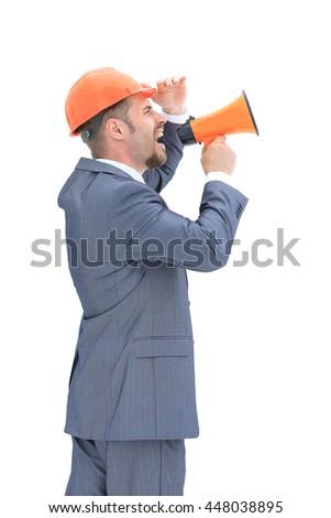 Confident engeneer with megaphone - stock photo