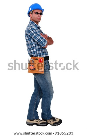 Confident entrepreneur standing on white background - stock photo