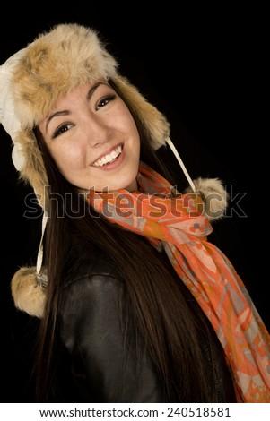 Confident ethnic teen wearing winter scarf hat - stock photo