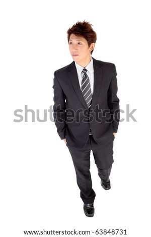 Confident executive walking, full length portrait isolated on white.
