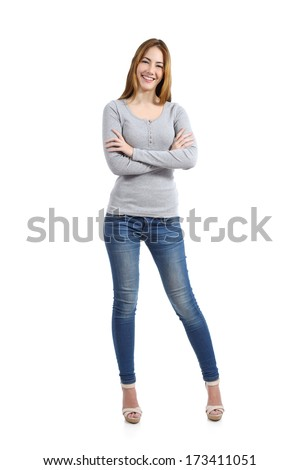 Confident full body of a casual happy woman standing wearing jeans isolated on a white background               - stock photo