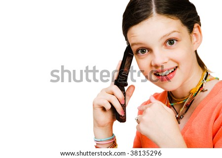 Confident girl talking on a mobile phone isolated over white - stock photo
