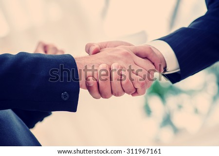 Confident hands shaking. Firm shakingdhand process