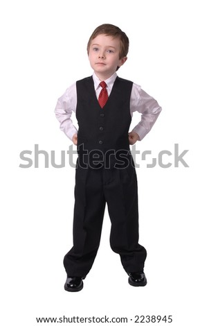 confident handsome attractive young boy dressed in suit looks off to his bright future on white background. - stock photo