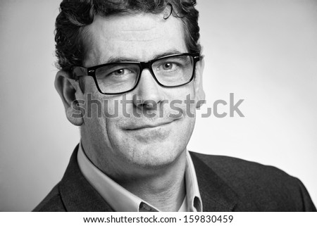 Confident handsome businessman closeup portrait black and white  - stock photo