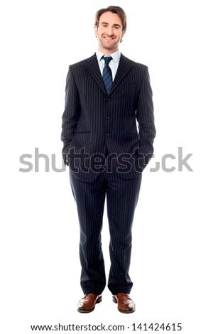 Confident handsome businessman, full length shot - stock photo