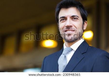 Confident handsome businessman outdoor - stock photo