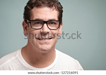 Confident handsome man with glasses closeup portrait - stock photo