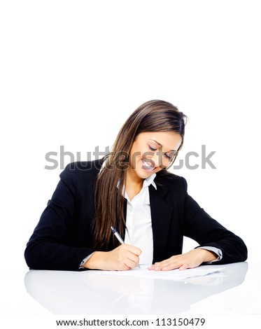 Confident happy businesswoman signing contract at her desk isolated on white background - stock photo
