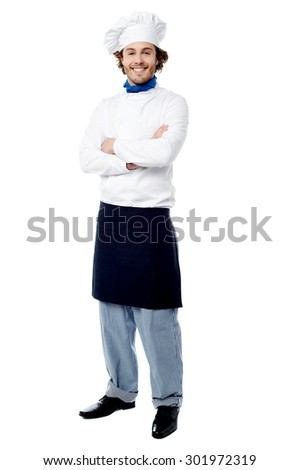Confident happy male chef posing to camera
