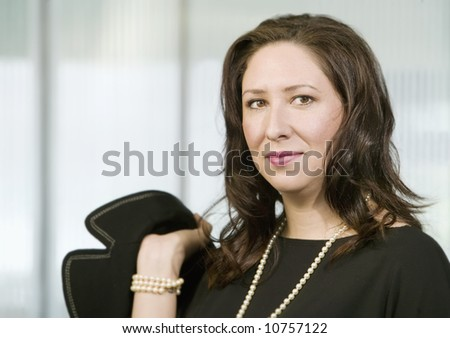 Confident Hispanic Woman Wearing pearls - stock photo