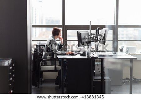Confident independent business woman working in corporate office. Female equality in business and entrepreneurship concept. - stock photo