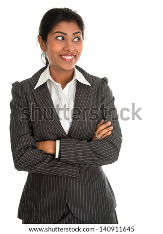 Confident Indian businesswoman hands folded in business suit smiling looking at side, standing isolated on white background. Asian female model. - stock photo